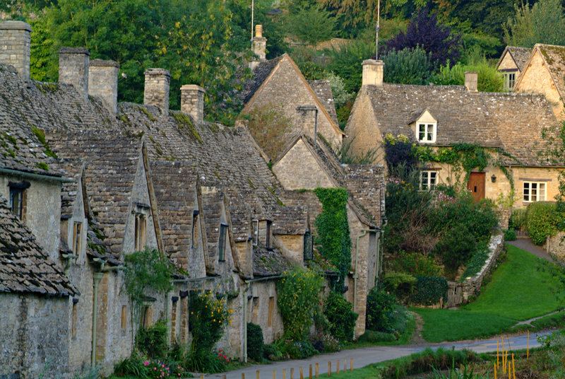 Quaint stone cottages in the Cotswold village of Bibury, Bibury, Gloucestershire, England.